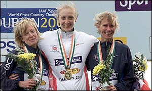 Deena Drossin, Paula Radcliffe and Colleen De Reuck on the podium after the senior womens long race during the IAAF World Cross Country which Radcliffe won