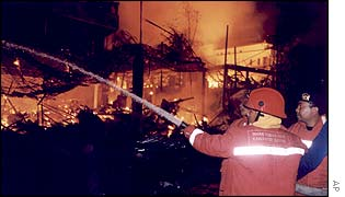 Firemen try to put out the flames at the Sari nightclub on Kuta Beach, on the island of Bali, Indonesia, early Sunday morning, 13 October 2002.