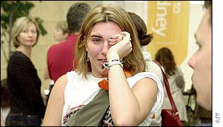 Jamie Brendt who was in the Sari Bar at the time of a huge bomb blast in Bali arrives at Sydney International Airport to be greeted by families and friends 14 October 2002