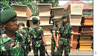 Indonesian soldiers in front of empty coffins outside a hospital in Denpasar, Bali