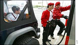 Members of the Guardian Angels at a fuel station in Alexandria