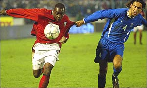 Emile Heskey (left) is held back by Slovakia's Peter Hlinka