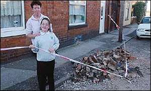 A mother and daughter survey their smashed chimney in Bloxwich after the earthquake