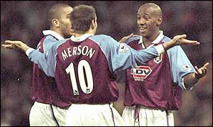 Villa team-mates Stan Collymore and Paul Merson congratulate Dion Dublin after another strike