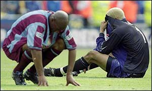 Aston Villa's Dion Dublin and David James contemplate defeat to Chelsea in the 2000 FA Cup final