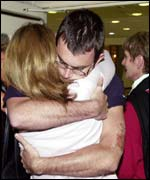 Jonathan Hartery is hugged by his mother