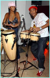 So Solid's Harvey and Misteeq's  Aleesha perform on the Bongos for the crowd...