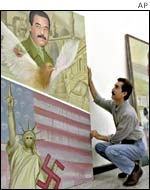Iraqi painter shows anti-US picture alongside one of Saddam Hussein