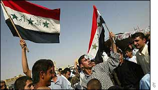 Iraqis waving the national flag