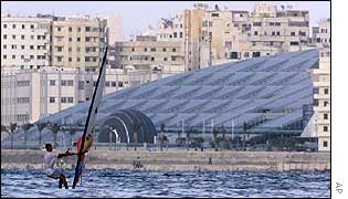A windsurfer sails past the new Alexandria library