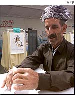 A Kurdish man votes north of Baghdad