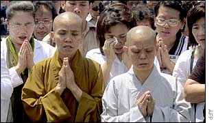 Buddhists and others pray during a memorial services in Denpasar, the capital city of Bali, 15 October 2002