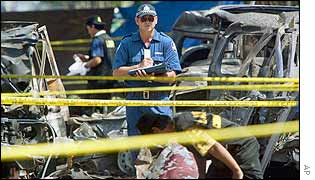 An officer of Australian Forensic team investigates the site of the deadly nightclub bombing in Kuta, Bali, Indonesia, 16 Oct 2002.