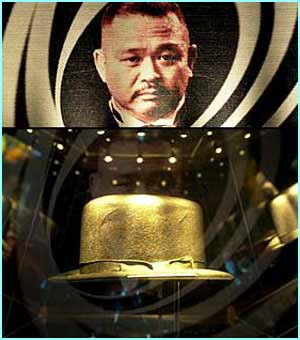 Oddjob's deadly hat from Goldfinger is shown near Rosa Klebb's flick knife shoes and Jaws' teeth