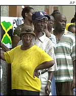 Jamaicans in Kingston line up to vote at a polling station