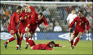 Macedonia's players celebrate Vanco Trajanov giving the side the lead