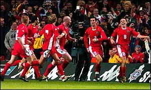 Wales' players celebrate a famous 2-1 victory over Italy