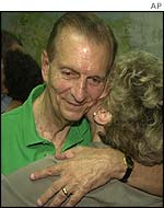 Edward Seaga hugging his wife