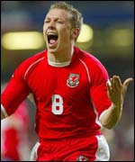Craig Bellamy celebrates scoring the winner for Wales