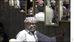 A mirror seller in the Yemeni capital, Sanaa
