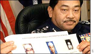 Malaysian police chief Norian Mai holds a copy of the photos of arrested militants on Wednesday