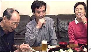 Kaoru Hasuike (right) chats with his father, Hidekazu, during a sushi dinner