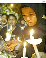 An Indonesian student mourns the dead