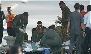 A victim is prepared for their flight to the Royal Perth Hospital, Australia
