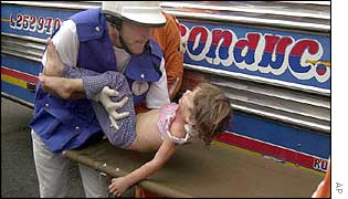 An injured girl is taken for treatment in Medellin