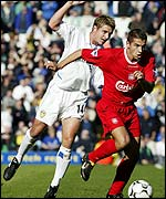 Milan Baros of Liverpool gets past Stephen McPhail of Leeds