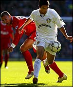 Leeds' Harry Kewell goes past Liverpool's Bruno Cheyrou