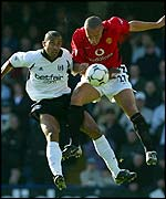 Fulham's Alain Goma and Manchester United's Mikael Silvestre