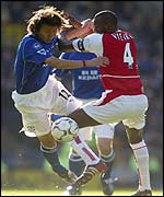 Everton's Li Tie and Arsenal's Patrick Vieira battle for the ball