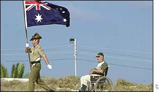 Bill Duff, in wheelchair, who was in the Australian air force during WWII near a soldier at the British cemetery in El Alamein