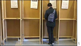 A voter in a polling booth in Dublin