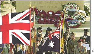 The British flag waves as state representatives leave the cemetery following a wreath-laying ceremony