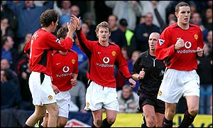 Manchester United striker Ole Gunnar Solskjaer celebrates his equaliser