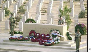 British soldiers stand guard near wreaths