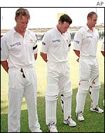 The Australian cricket team observes a minute of silence before their match against Pakistan
