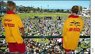 Surf lifesavers watch the memorial service