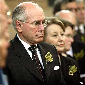 John Howard and wife Janette at service in Canberra