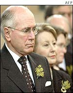 Australian Prime Minister John Howard (left) with his wife Janette attend a national day of mourning service in Canberra