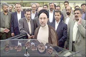 Iranian President Mohammad Khatami (centre) with MPs and bodyguards outside the parliament