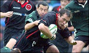 Edinburgh's Alastair Dickson is tackled by London Irish's Barry Everitt