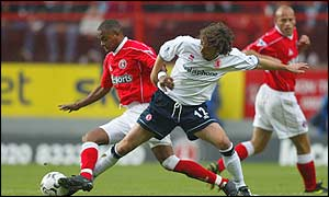 Charlton's Shaun Bartlett battles with Boro's Jonathan Greening