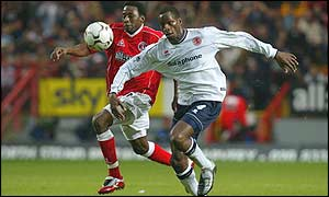 Charlton's Jason Euell battles for the ball with Middlesbrough's Ugo Ehiogu