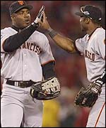 San Francisco's Barry Bonds and Reggie Sanders.