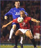Rooney tussles with Silvestre of Manchester United