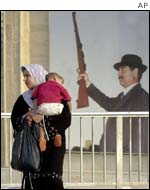 Iraqi woman with picture of Saddam Hussein
