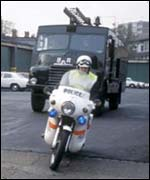 A Green Goddess and police escort, 1977